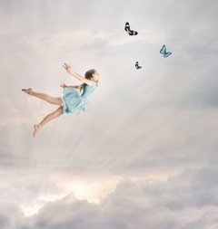 stockfresh_1930376_little-girl-flying-at-twilight_sizeXS