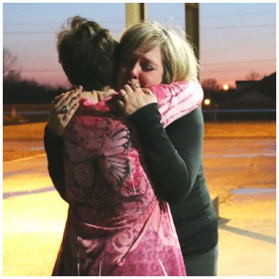 Teresa Parker, left, hugging Devin Muller at Sweet Grace study in April, 2014.